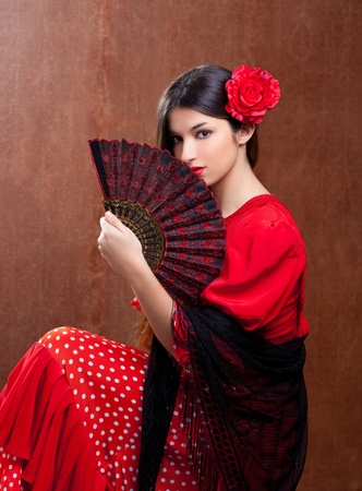 Flamenco dancer Spain woman gipsy with red rose and spanish hand fan photo