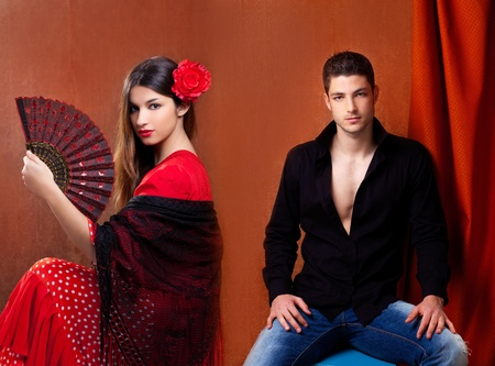 Gipsy flamenco dancer couple from Spain with red rose and spanish hand fan photo