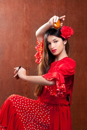 Castanets gypsy flamenco dancer Spain girl with red rose photo