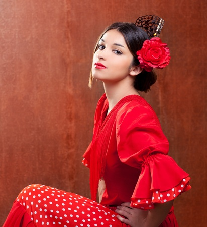 Flamenco dancer Spain woman gipsy with red rose and spanish peineta comb photo