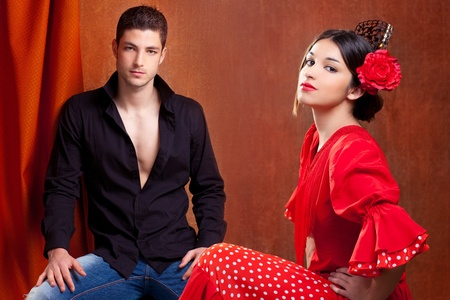 Gipsy flamenco dancer couple from Spain with red rose and spanish back comb peineta photo