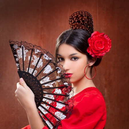 Flamenco dancer Spain woman gypsy with red rose and spanish hand fan photo
