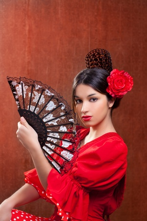 Flamenco dancer Spain woman gypsy with red rose spanish hand fan and peineta comb photo
