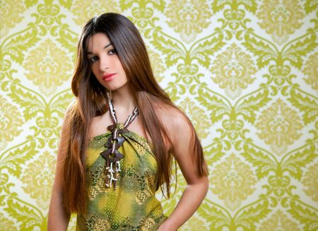 Asian Indian brunette beautiful girl with long hair on retro wallpaper photo
