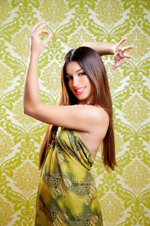 Asian Indian brunette girl with long hair dancing with hands up photo
