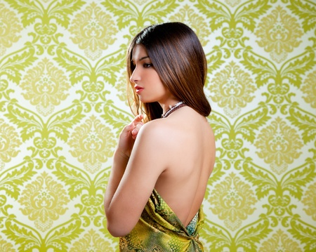 profile: Asian Indian brunette beautiful girl with sexy open back dress Stock Photo