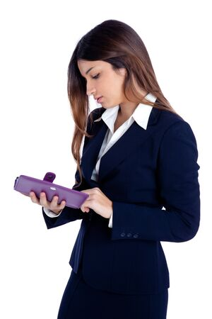 asian indian business woman reading ebook tablet pc notebook and blue suit on white photo