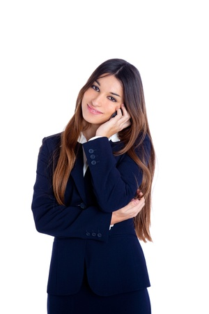 brunette business woman talking mobile phone happy smiling with blue suit on white photo