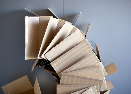 carton open boxes stacked on curved circle shape on gray wall Stock Photo - 13601177