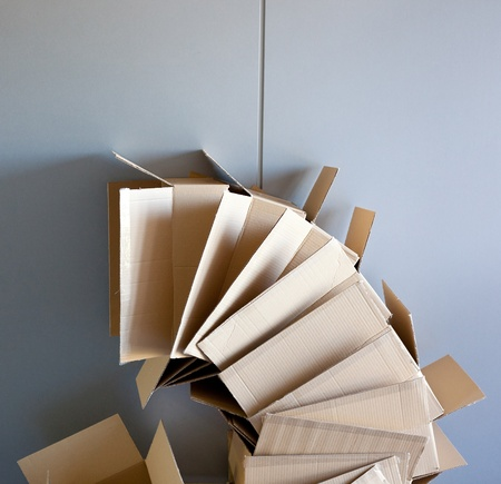 carton open boxes stacked on curved circle shape on gray wall photo
