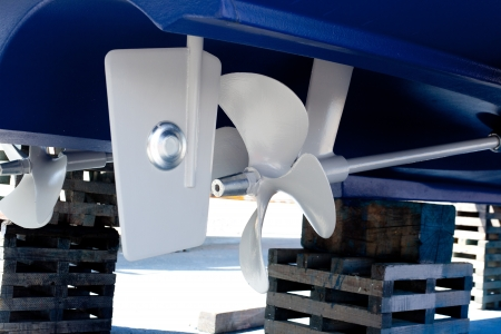 gray painted propeller and steering with zinc anodes in blue hull
