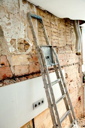 demolition debris in kitchen interior construction and ladder photo