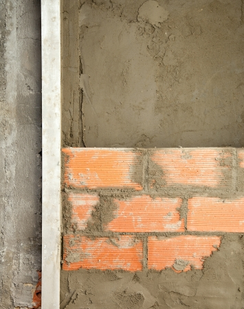 brickwall construction and mortar cement plaster with rulers Stock Photo - 13601790