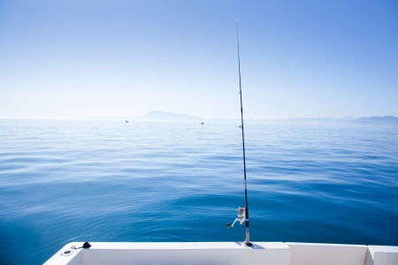 boat fishing rod in mediterranean blue sea in Spain Stock Photo - 13601190