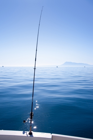 boat fishing rod in mediterranean blue sea in Spain photo