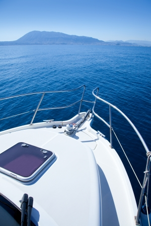 boat sailing in Mediterranean sea with Denia Mongo mountain photo