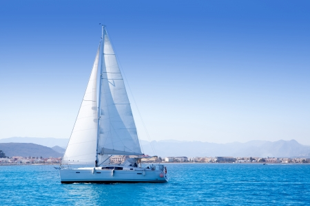 sail boat: sailboat sailing in Mediterranean sea in Denia blue Mediterranean Stock Photo