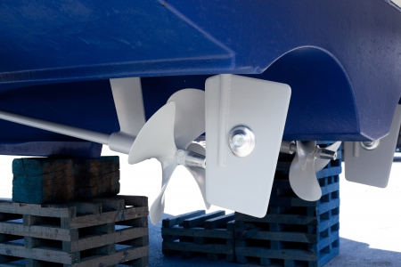 gray painted propeller and steering with zinc anodes in blue hull photo