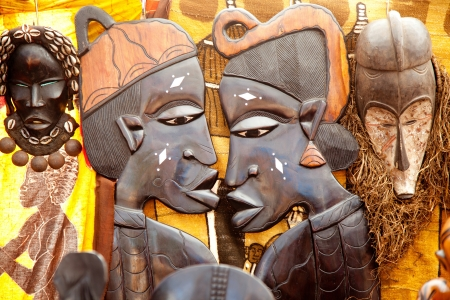 african handcraft dark wood carved profile faces