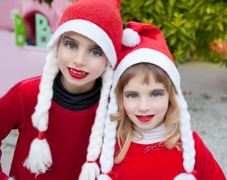 Christmas santa costumer kid girls makeup portrait smiling outdoor photo