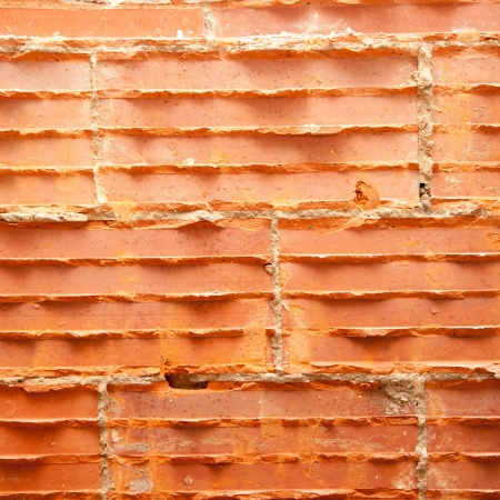 broken bricks in brickwall in wall restoration construction photo