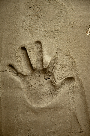 hand print on cement mortar wall with shadow relief photo