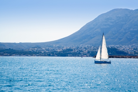 mongo: sailboat sailing in Mediterranean sea with Denia Mongo mountain Stock Photo