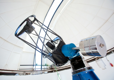 astronomic: Astronomic observatory telescope inside a white dome Editorial