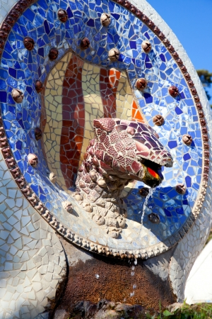 guell: Barcelona Park Guell of Gaudi Snake and four Catalan bars in modernism mosaic