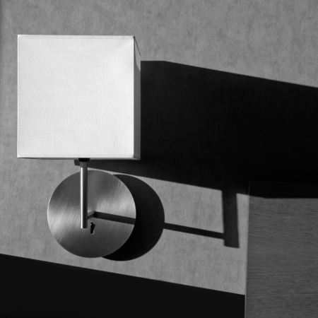 Black and white modern lamp detail with shadows in the wall photo