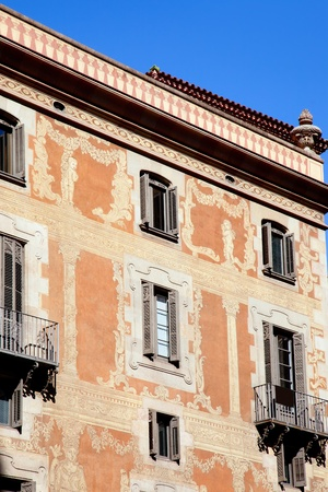 alt: Barcelona city buildings facade in Sant Pere mes Alt street Stock Photo