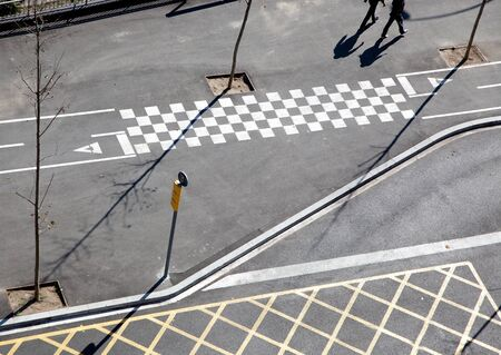 dividing lines: City asphalt lines and shadow aerial view in Barcelona