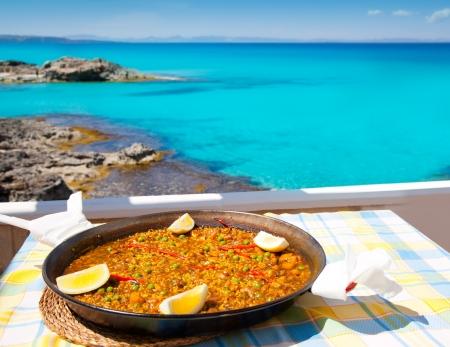 Paella mediterranean rice food by the Balearic Formentera island beach