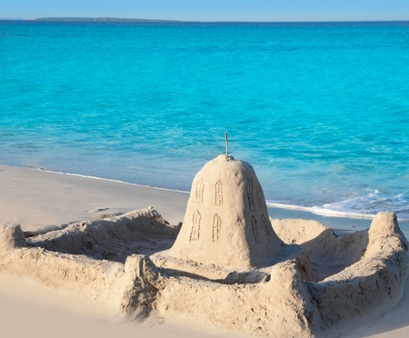tropical beach with castle in shore white sand photo