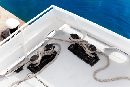 Boat double bitt detail with rope moored in port marina Stock Photo - 14266712