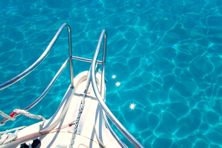Balearic blue clean turquoise water from boat bow high angle view photo
