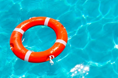 Buoy orange round floating in perfect tropical beach with turquoise water photo