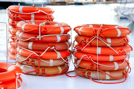 Buoys round lifesaver stacked for boat safety equipment photo