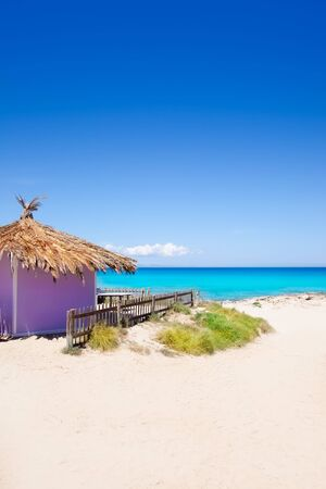 Formentera tropical purple hut on turquoise white sand beach photo