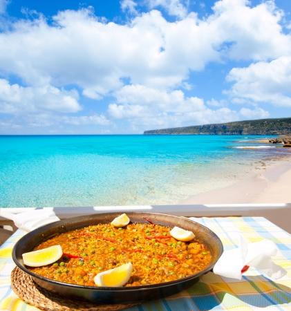 beaches of spain: Paella mediterranean rice food by the Balearic Formentera island beach