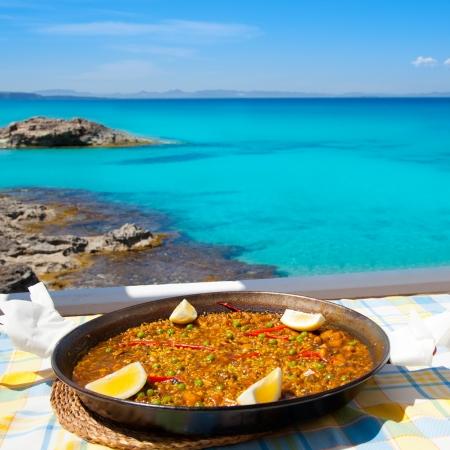 Paella mediterranean rice food by the Balearic Formentera island beach photo