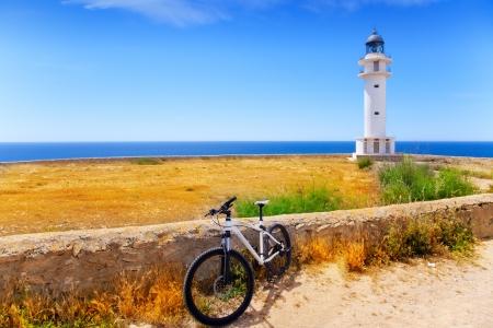 baleares: bicycle on Balearic island of Formentera near Barbaria cape Lighthouse