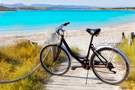 parked bicycles: Bicycle in formentera beach on Balearic islands at Illetes Illetas