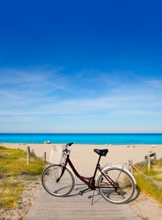 parked bikes: Bicycle in formentera beach on Balearic islands at Levante East Tanga Stock Photo