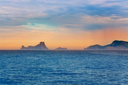vedra: Ibiza sunset Es Vedra in Balearic islands view from Mediterranean sea