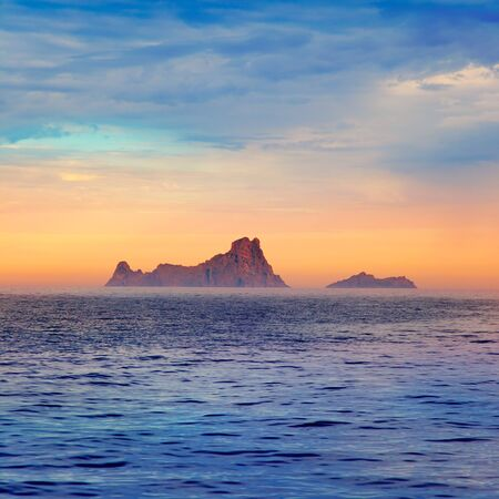 Ibiza sunset Es Vedra in Balearic islands view from Mediterranean sea photo