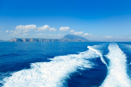 mongo: Alicante Denia view from blue Mediterranean and boat wake in Spain Stock Photo