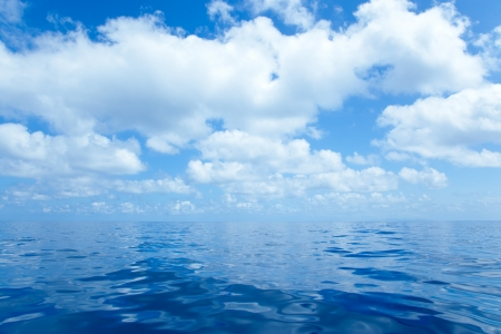 mirror on the water: Blue calm sea water in offshore ocean with clouds mirror surface