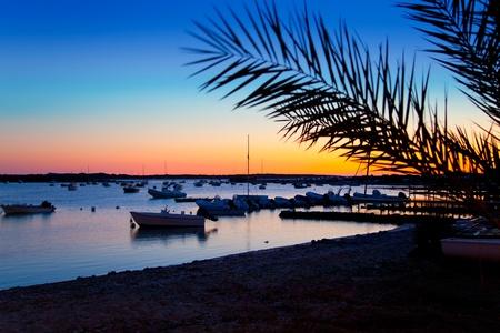 Formentera sunset in se estany des peix lake lagoon photo