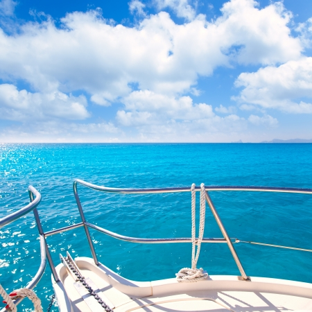 Anchor boat y tropical idyllic tropical turquoise beach under blue sky and clouds photo